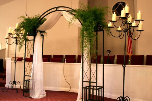 The ceremony alter area was defined with a wrought iron arch and candleabras